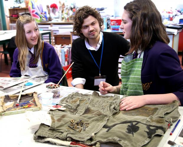 The Advertiser Series: WWI THEME: Poet John Challis with pupils at Bishop Barrington School on a WW1 project, pictured here talking to Abigail Edwards, 13, (left) and Evie Bushby, 14.