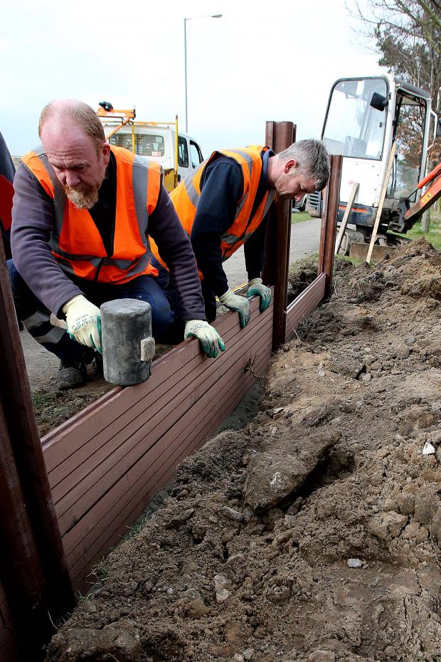 The Advertiser Series: FLOOD DEFENCE: Work starts on flood wall for village