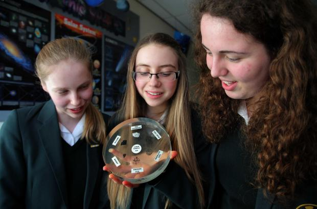 The Advertiser Series: Science pupils (from left) Hollie Bell, 14, Lucy Walker, 15 and Lucy Roberts, 14, from Durham High School for Girls examine moon samples from NASA