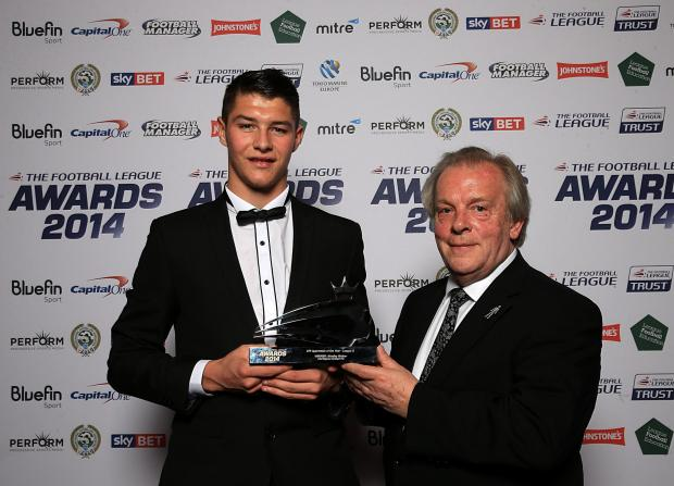 The Advertiser Series: AWARDS DO: Bradley Walker receives his award for apprentice of the year from PFA chief Gordon Taylor at the Football League Awards in London on Sunday evening