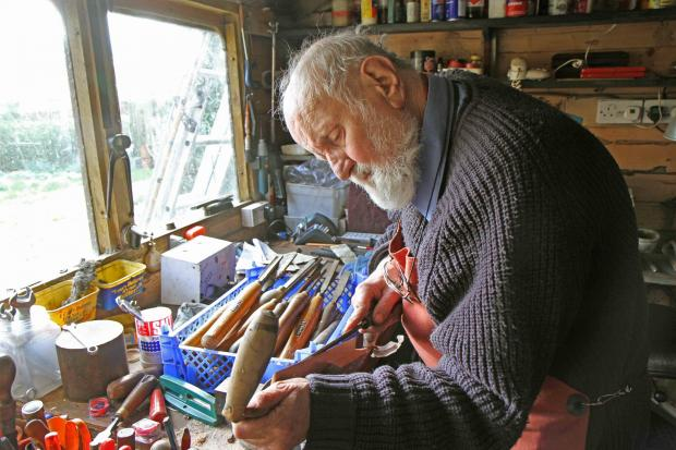 The Advertiser Series: Mark Henshaw at work in his shed.