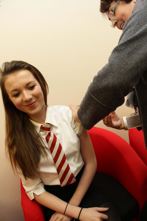 The Advertiser Series: DSMS student Charis Bell, 14, receives her yellow fever jab from Dr Diane Wasson