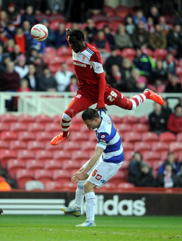 The Advertiser Series: AIR PLAY: Middlesbrough's Kei Kamara leaps over QPR's Clint Hill during the Londoners' 3-1 win on Saturday at the Riverside Stadium