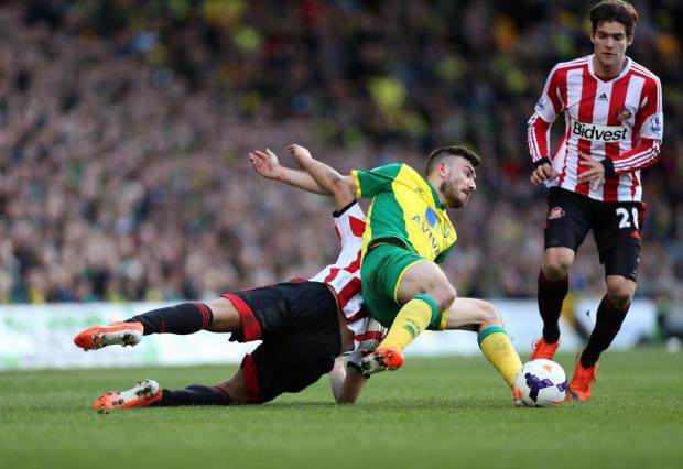 The Advertiser Series: TAKING A TUMBLE: Sunderland's Wes Brown goes to ground in a clash with Robert Snodgrass