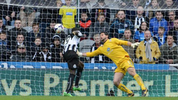 The Advertiser Series: DECISIVE STRIKE: Papiss Cisse leaps to head Newcastle's late winner against Crystal Palace