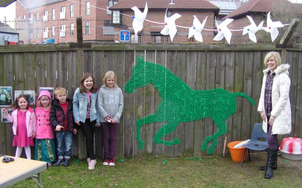 The Advertiser Series: Youngsters show off their horse mural created out of milk carton tops at Scrap Studioarts