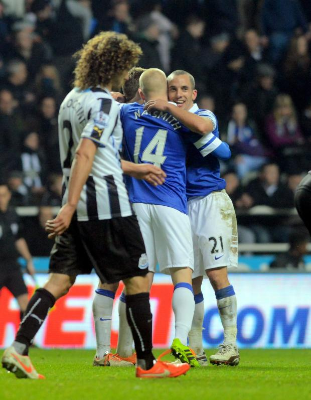 The Advertiser Series: DEFLATED: Newcastle United captain Fabricio Coloccini back to his position as Leon Osman celebrates making it 3-0 to Everton last night at St James' Park