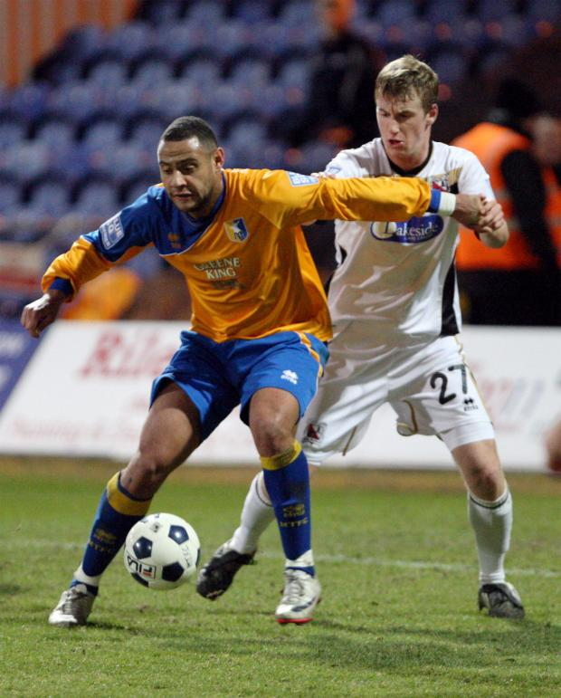 The Advertiser Series: LOAN MOVE: Scott Harrison, right, pictured playing in 2011- 12 for Darlington where he came through the youth ranks, has joined Hartlepool United on loan from Sunderland