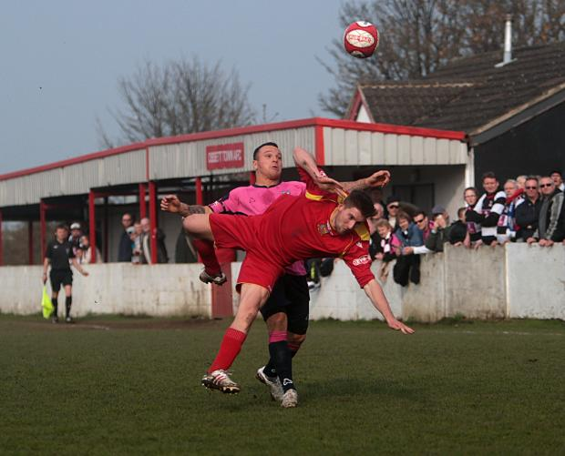 The Advertiser Series: FALLING DOWN: Quakers' Stephen Thompson tangles with an Ossett Town opponent