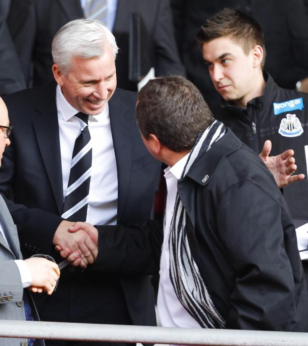 The Advertiser Series: SEASON'S GREETINGS: Manager Alan Pardew shakes hands with owner Mike Ashley at St Mary's