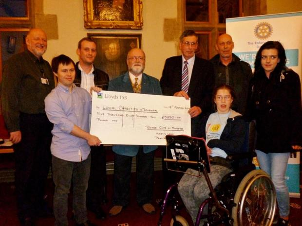 The Advertiser Series: Charity representatives receive money raised