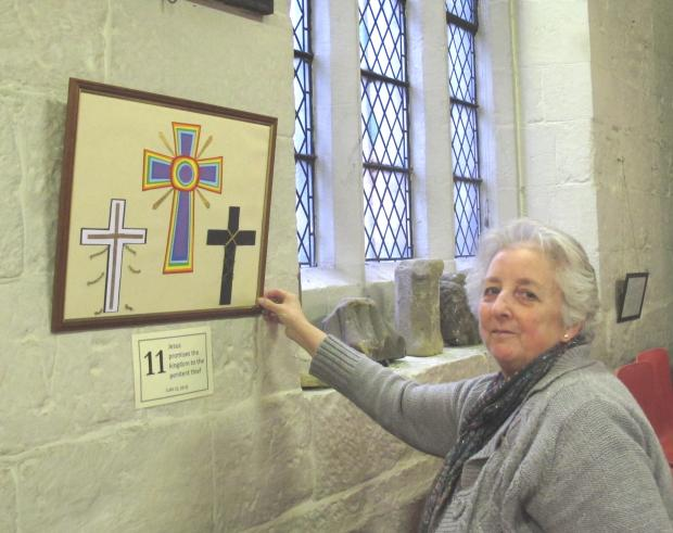 The Advertiser Series: Church member Margaret Rochester with the Station of the Cross which she created.