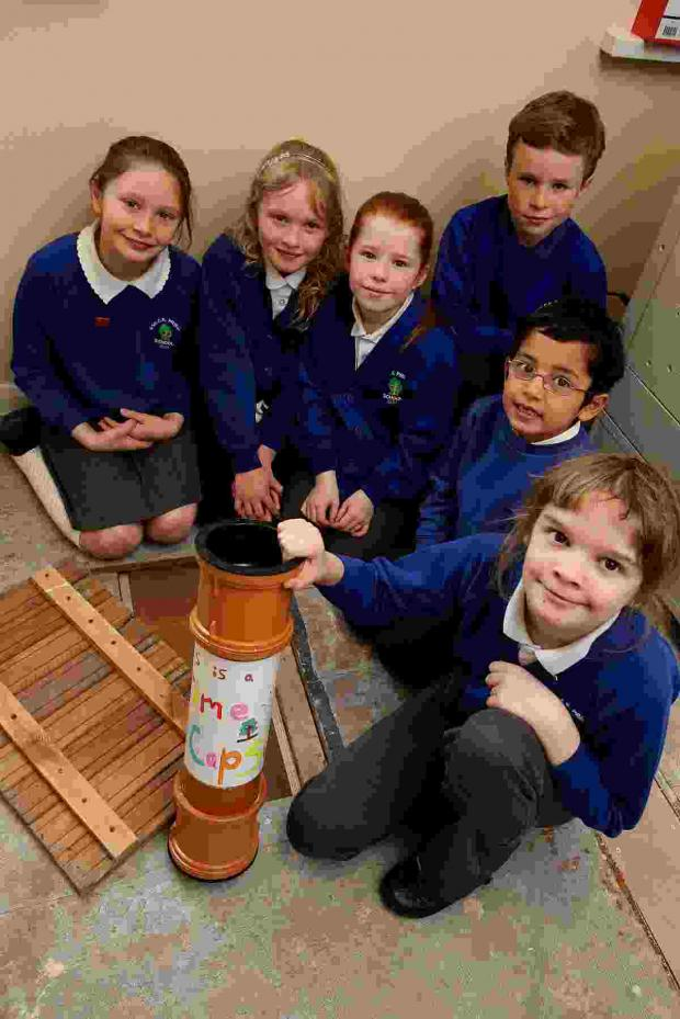 The Advertiser Series: Student council members Erin Clarke (9), Abi McCourt (8), Darcy Crook (7), Leuan Auyeung (6), Ruth Peers (11) and Charlie Phillips (10) with the time capsule.