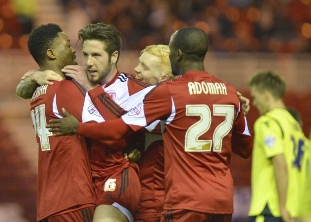 The Advertiser Series: DOUBLE JOY: Jacob Butterfield is mobbed by his Boro teammates after making it 2-0 last night, striking in a volley from distance