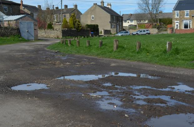 The Advertiser Series: POTHOLE PROBLEMS: The track which borders part of Evenwood village green is in urgent need of resurfacing.