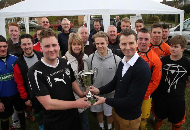 The Advertiser Series: Hartlepool boss Colin Cooper presents a charity trophy to captain o