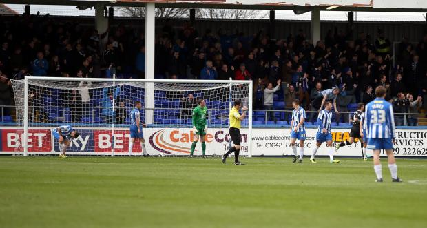 The Advertiser Series: MOMENT OF DESPAIR: Hartlepool players are dejected after Chesterfield net their winning goal