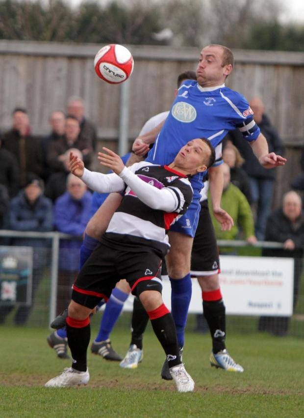 The Advertiser Series: MY BALL: Padiham centre-back Martin Parkes climbs above Quakers' Stephen Thompson
