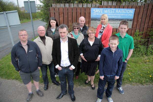 The Advertiser Series: Michael Johnson (in white shirt, centre) with villagers who are opposed to building at West Rainton.