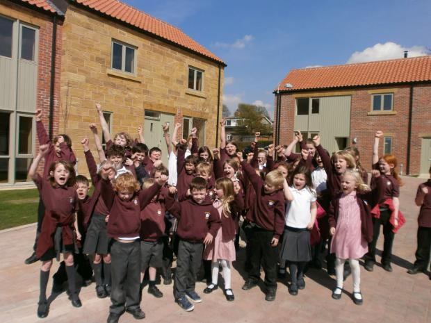 The Advertiser Series: Children from Osmotherley School Primary School celebrate the opening of the award-winning affordable housing development