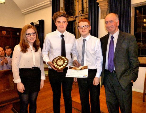 The Advertiser Series: Sarah Kingston, Christian Thompson-Hails and Joshua Morgan from Framwellgate School Durham receive the Youth Speak shield from Phil Mars, of Durham Rotary Club
