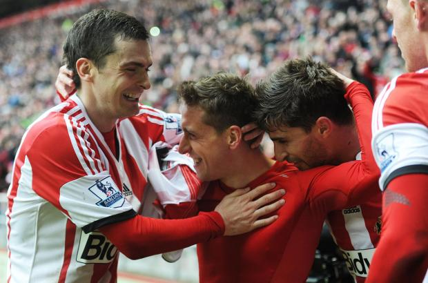 The Advertiser Series: CELEBRATORY SCENES: Sunderland's players celebrate with Emanuele Giaccherini after the winger scored Sunderland's third goal in a 4-0 win over Cardiff