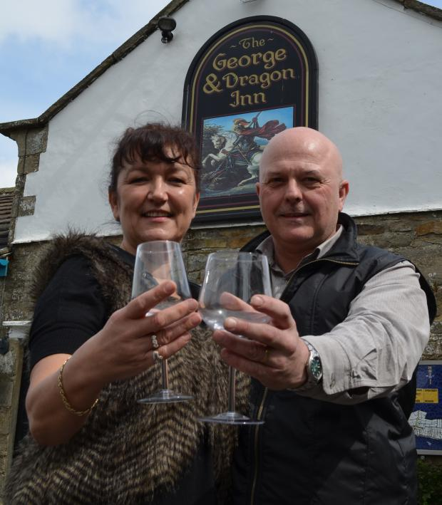 The Advertiser Series: BACK IN BUSINESS: Julie and Terry Race raise a glass to toast the reopening of the George and Dragon, at Boldron.