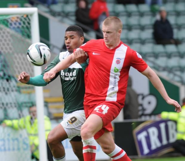 The Advertiser Series: MY BALL: Hartlepool's Scott Harrison tussles with Plymouth's Reuben Reid during Saturday's 1-1 draw at Home park