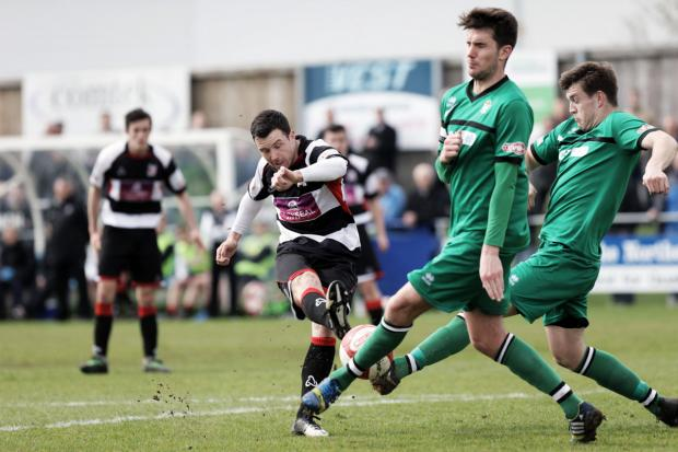 The Advertiser Series: AIM AND FIRE: Darlington striker Nathan Fisher attempts to get a shot in against Burscough