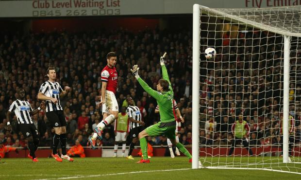 The Advertiser Series: FREEDOM: Arsenal's Olivier Giroud scores his side's third goal of the game, heading in from close range as defender Mike Williamson stands off