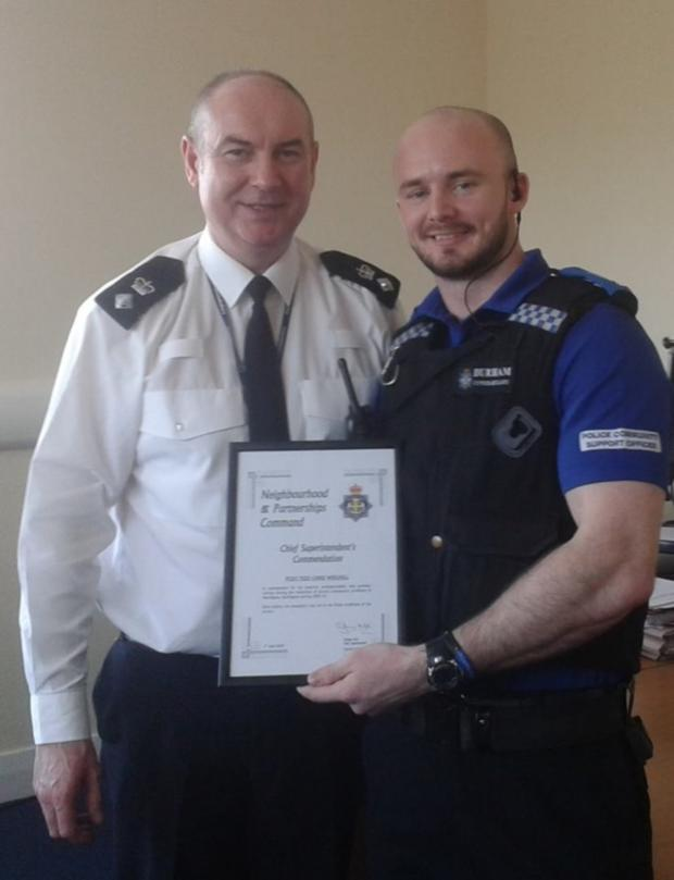 The Advertiser Series: WELL DONE: PCSO Chris Weighill, right, receives his Chief Constable's commendation from Chief Superintendent Graham Hall