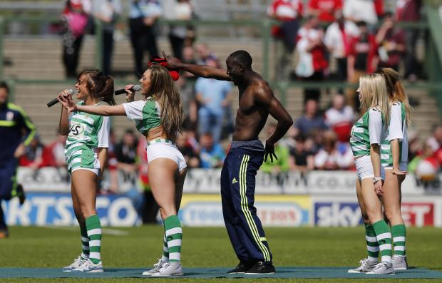 The Advertiser Series: Middlesbrough's Albert Adomah joins girl band Viva Pitch for an inpromptu dance routine after the final whistle at Huish Park. Photo: Phil Mingo/Pinnacle