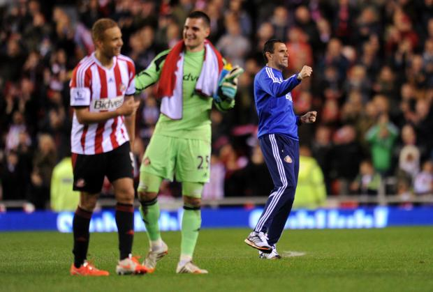 The Advertiser Series: WEARSIDE HEROES: Gus Poyet leads the celebrations, as Wes Brown and Vito Mannone celebrate securing their Premier League status.