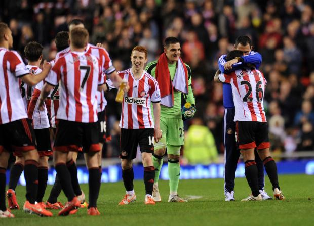 The Advertiser Series: RELIEF: Gustavo Poyet and his Sunderland players celebrate saving their Premier League status