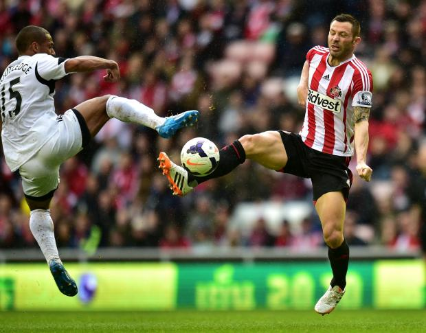 The Advertiser Series: HIGH BALL: Sunderland defender Phil Bardsley tussles for possession with Wayne Routledge