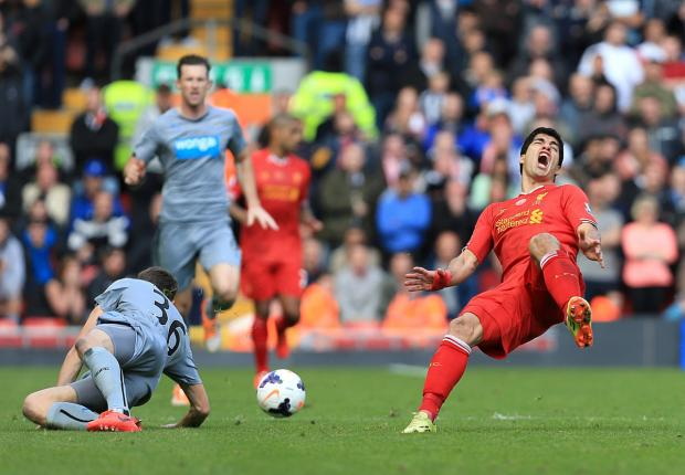 The Advertiser Series: BAD CHALLENGE: Luis Suarez falls to the ground after a Paul Dummet tackle, which led to the Newcastle left-back being sent off