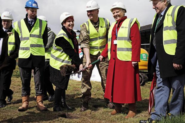 The Advertiser Series: NEW DEVELOPMENT: Col. Stephen Padgett cuts the first sod at a new retail development at Catterick Garrison.