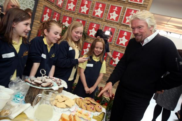 The Advertiser Series: Sir Richard Branson meets pupils from West Jesmond Primary School in Newcastle taking part in Virgin Money's Fiver Challenge, which gives young entrepreneurs a chance to start their own business with a £5 loan. All profits are retained by the school.