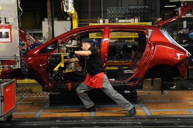 The Advertiser Series: RELIABILITY STUDY: A Nissan worker fits the dashboard to an all-electric Leaf at the firm's Sunderland plant