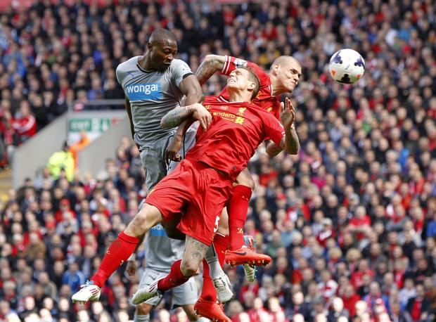 The Advertiser Series: Anfield defeat: Newcastle striker Shola Ameobi battles for the ball with Liverpool's Daniel Agger and Martin Skrtel during the 2-1 defeat at Anfield on Sunday. PRESS ASSOCIATION Photo.