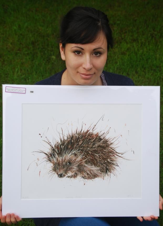 The Advertiser Series: HELPING ANIMALS: Aaminah Snowdon with her hedgehog painting.