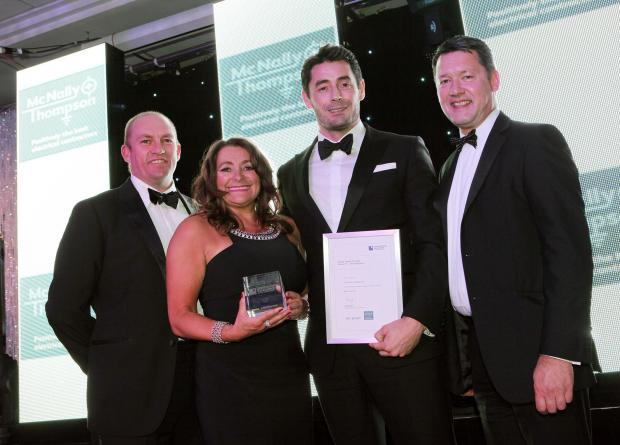 The Advertiser Series: AWARD SUCCESS: Pictured from left to right are Gus Robinson's land and development director Steve Bell, financial director Jeanette Henderson, and chairman Dan Robinson, with Fred Hood, managing director of McNally and Thompson, who presented the awar