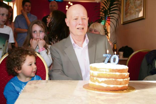 The Advertiser Series: HAPPY BIRTHDAY: Prof Hildreth blows out his candles watched by son Max