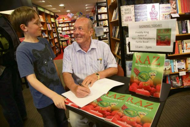 The Advertiser Series: RAZ FAN: Author Freddy King signs a copy of Raz for eleven-year-old Leon Nicholas from Northallerton at the town's Waterstone's book store. Picture: ANDY LAMB