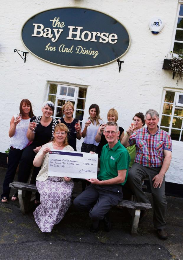 The Advertiser Series: COMMUNITY FUNDRAISING: A local community group in Heighington have raised over £1200 for Macmillan cancer support, pictured front Sue Flint presents the chequ