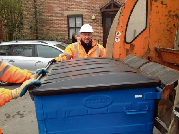 The Advertiser Series: Mr Abell joins a bin crew at work.