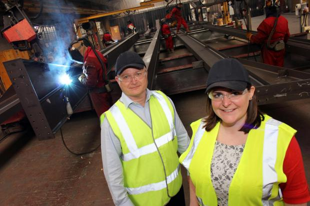 The Advertiser Series: STRONG TEAM: Finley Structures' new senior quantity surveyor Diane Ruston with operations manager Jim Graham. They are pictured in the company's plant as staff work on steel for Hitachi Rail Europe's Newton Aycliffe £82m factory
