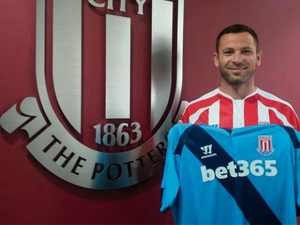 The Advertiser Series: NEW BOY: Phil Bardsley holds the Stoke City shirt aloft after signing for the Potters from Sunderland yesterday