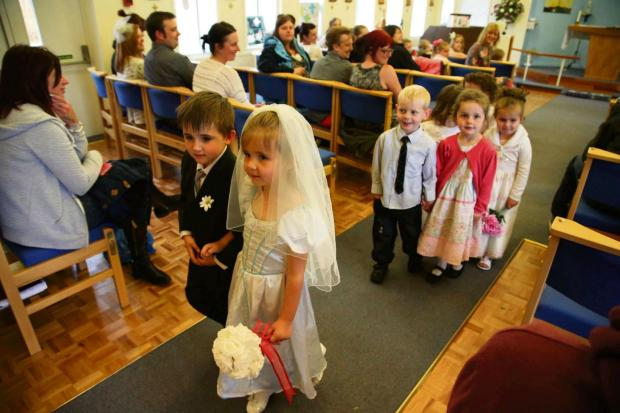 The Advertiser Series: WEDDING DAY: Four-year-olds Madison Evans and Jacob Nicholson walk down the aisle after their mock wedding at St Colomba's Church, Darlington   Picture: ANDY LAMB