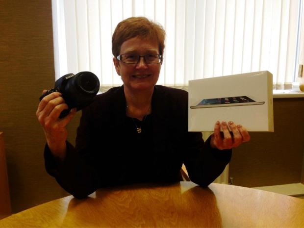 The Advertiser Series: ON OFFER: Anne Rowlands, chief executive of Railway Housing Association, with one of the iPads being given away